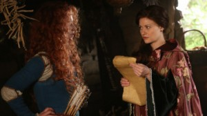 "ONCE UPON A TIME - ""The Bear and the Bow"" - In a Camelot flashback, a chance encounter with Merlin, David, Hook and Belle gives Merida new hope in her quest to save her brothers from the usurping clans of DunBroch. Unwilling to leave anything up to fate, Merida brings Belle along on a dangerous journey that culminates with an invaluable lesson in bravery. In Storybrooke, Regina, Mary Margaret and David discover the spell that would allow one of Merlin's chosen to communicate with him, but when Arthur fails to reach the missing sorcerer the heroes grow suspicious. Meanwhile, Emma commands Merida to kill Belle in hopes of forcing Mr. Gold's heroic transformation. With Merida unable to disobey Emma's orders, Gold must find the courage to fight for Belle's life or risk losing her forever, on ""Once Upon a Time,"" SUNDAY, NOVEMBER 1 (8:00-9:00 p.m., ET) on the ABC Television Network. (ABC/Jack Rowand) AMY MANSON, EMILIE DE RAVIN"